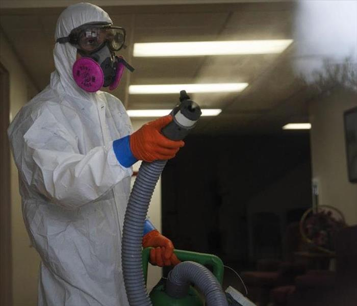 A SERVPRO technician fogging a commercial property with CDC certified product to destroy viral pathogens.